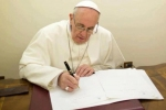 Pope Francis writing 740x493